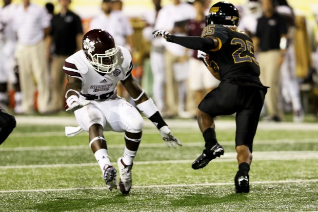 Southern Miss running back Ito Smith dodging a Mississippi State player in Hattiesburg on Saturday night.