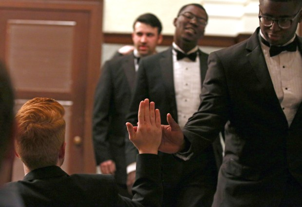 """The Southern Miss Showcase Concert of the Southern Invitational Choral Conference 2015 was held at Bennett Auditorium on the USM campus Monday, September 28, 2015.  Choral members """"high five"""" after a tune. Fadi Shahin/Student Printz"""