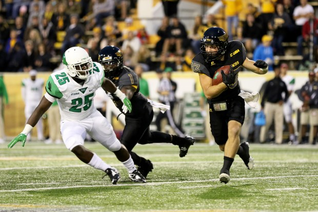 Southern Miss Wide Receiver Casey Martin evades a North Texas player Saturday night on October 3, 2015 in Hattiesburg, Mississippi. (Student Printz/ Hunt Mercier)