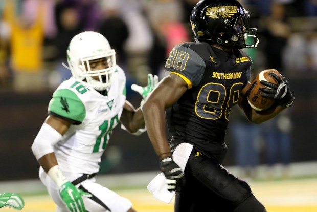 Southern Miss wide receiver Mike Thomas sprinted down the field as a North Texas player attempts to catch him on Saturday night in Hattiesburg, Mississippi on October 3, 2015. (Student Printz/ Hunt Mercier)