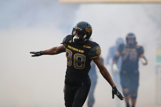 Southern Miss wide reciever Mike Thomas runs out onto the field to play against North Texas in Hattiesburg, Mississippi on October 3, 2015.