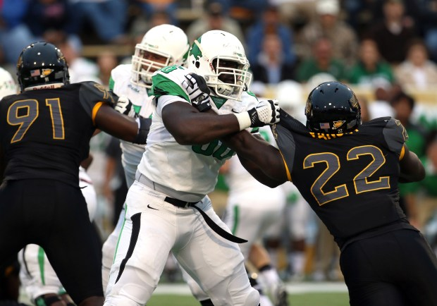 Southern Miss linebacker Darian Yancey pushes a North Texas player away Saturday night in Hattiesburg, Mississippi on October 3, 2015. (Student Printz/ Fadi Shahin)