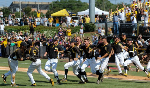 The Southern Mississippi Golden Eagles' baseball team runs out on the field celebrating the last out to win them the C-USA tournament against Rice University from Houston, Texas. The Golden Eagles won 3-2 on Sunday May 29, 2016 at Pete Taylor Park in Hattiesburg, Mississippi.