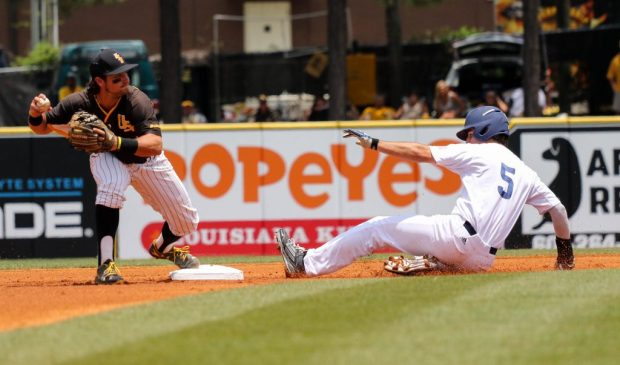 Southern Miss Golden Eagles' Nick Dawson tags a Rice player out at the C-USA tournament against Rice University at Pete Taylor Park in Hattiesburg, Mississippi on May 29, 2016.