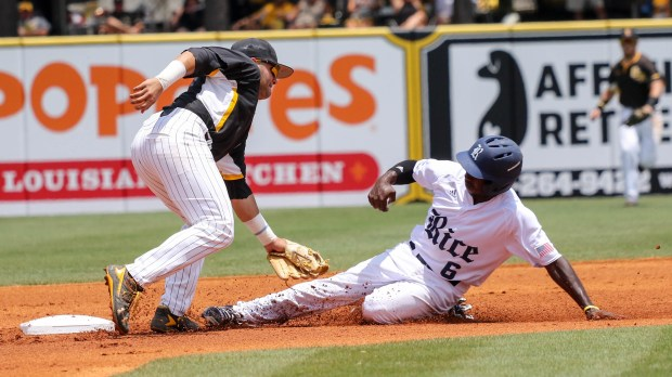 Southern Miss Golden Eagles' Chase Scott tags a Rice player out at the C-USA tournament against Rice University at Pete Taylor Park in Hattiesburg, Mississippi on May 29, 2016.