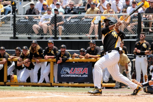 Southern Miss Golden Eagles' Chuckie Robinson swings and hits the ball at the C-USA tournament against Rice University at Pete Taylor Park in Hattiesburg, Mississippi on May 29, 2016.