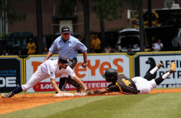 Southern Miss Golden Eagles' Tracy Hadley slides into base before a Rice player can tag him out at the C-USA tournament against Rice University at Pete Taylor Park in Hattiesburg, Mississippi on May 29, 2016.