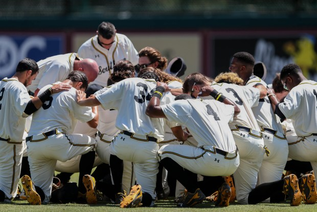 The Southern Miss Golden Eagles huddle together before they play South Alabama at the NCAA 2016 Division I baseball championship in Tallahassee, Florida on June 3, 2016.