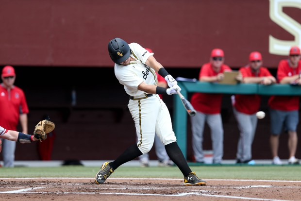 Dylan Burdeaux hits the ball thrown by a South Alabama pitcher at the 2016 NCAA Division I baseball championship in Tallahassee, Florida on June 3, 2016.