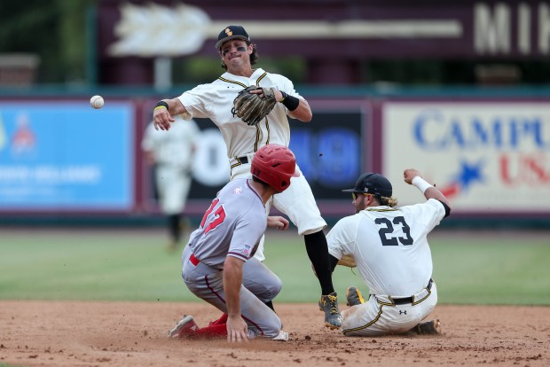 Nick Dawson tags a South Alabama player out at second base and throws it to first base at the 2016 NCAA Division I baseball championship in Tallahassee, Florida on June 3, 2016.