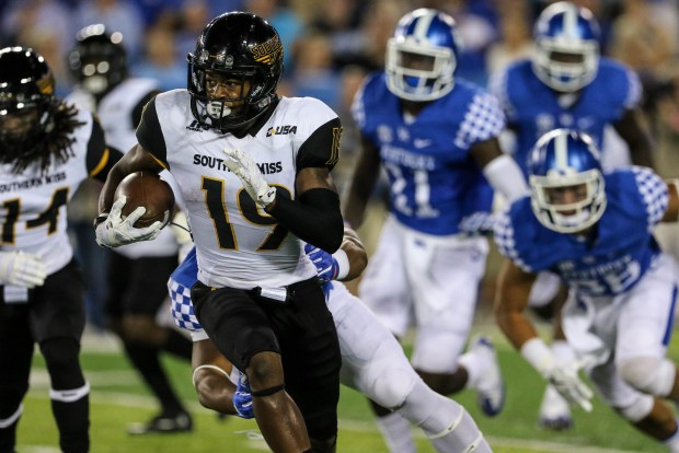 Southern Miss defensive back Curtis Mikell (19) runs the ball against the Kentucky Wildcats in Lexington, Kentucky on September 3, 2016. (Student Printz/ Hunt Mercier)