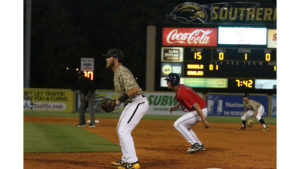 Dylan Burdeaux prepares for the throw to first base against the Ole Miss Rebels on April 11.