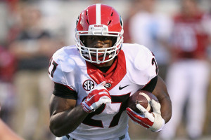 Oct 18, 2014; Little Rock, AR, USA; Georgia Bulldogs tailback Nick Chubb (27) rushes against the Arkansas Razorbacks at War Memorial Stadium. Georgia defeated Arkansas 45-32. Mandatory Credit: Nelson Chenault-USA TODAY