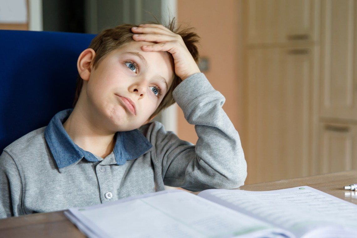 frustrated student working on homework