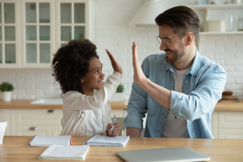 father daughter celebrate learning
