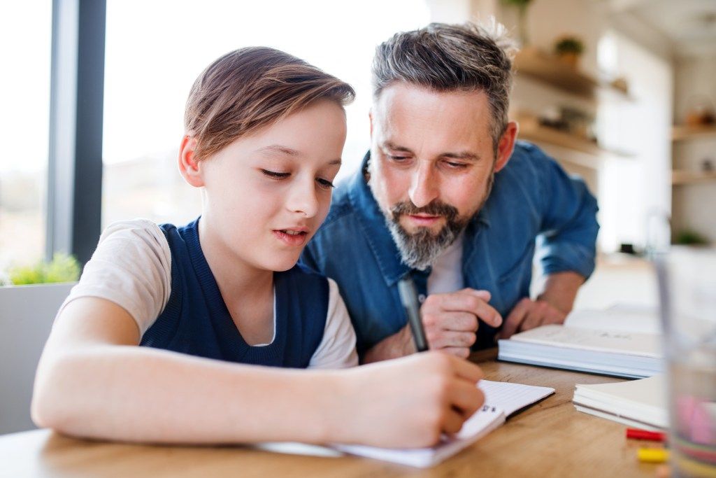 Father and child working on goals together