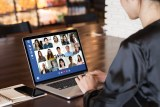 woman in video conference on laptop