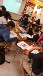 Reginald rights students in classroom