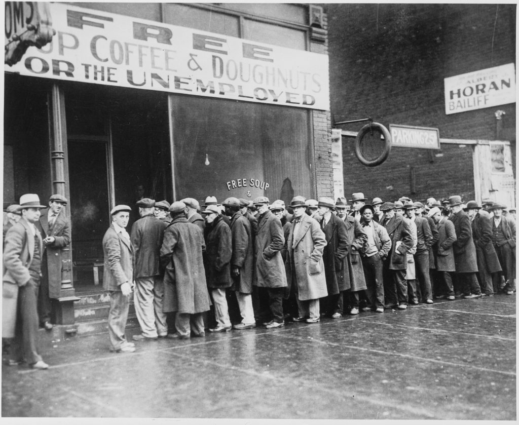 Men lined up at a soup kitchen during the Great Depression