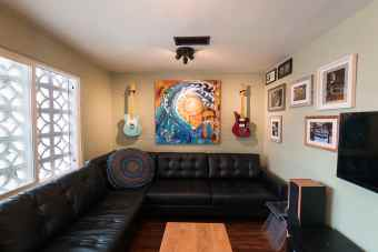 Lobby shot of guitars and paintings