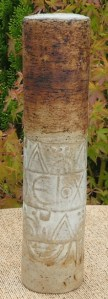 AW2 - Alan Wallwork: Coiled cylinder with hieroglyphic decoration made at Marnhull during the 1960s. Incised W mark + S mark for Sue who coiled the pot before Alan decorated it. The height is 26.4 cm (10.4 inches) and the diameter is 6.1 cm (2.4 inches). £275