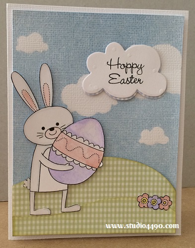 Hoppy Easter Materials used:  Stamps - Happy Easter Holiday (Close To My Heart); Dies - Clouds (Paper Smooches); Designer Paper - Unknown; Distress Ink;    Distress Markers; Mister Huey's Colour Mists - Powder Blue (Studio Calico) and Wink of Stella (Clear).