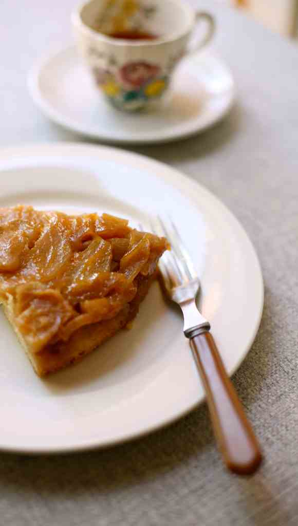 Apple Upside Down Cake on a white plate with a fork