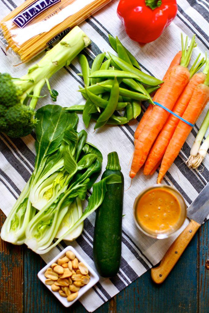 brocoli, beans, carrots, zucchini and Delallo spaghetto, knife and red peper on a striped napkin