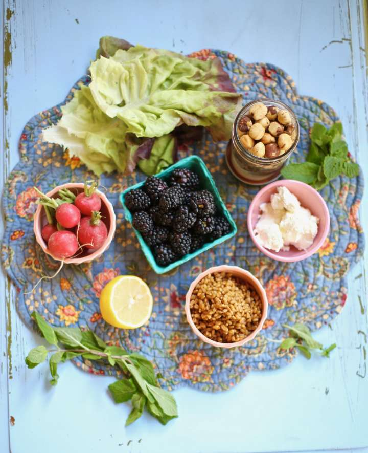 Inredients for Blackberry Salad with Toasted Hazelnuts on a blue placemat and table