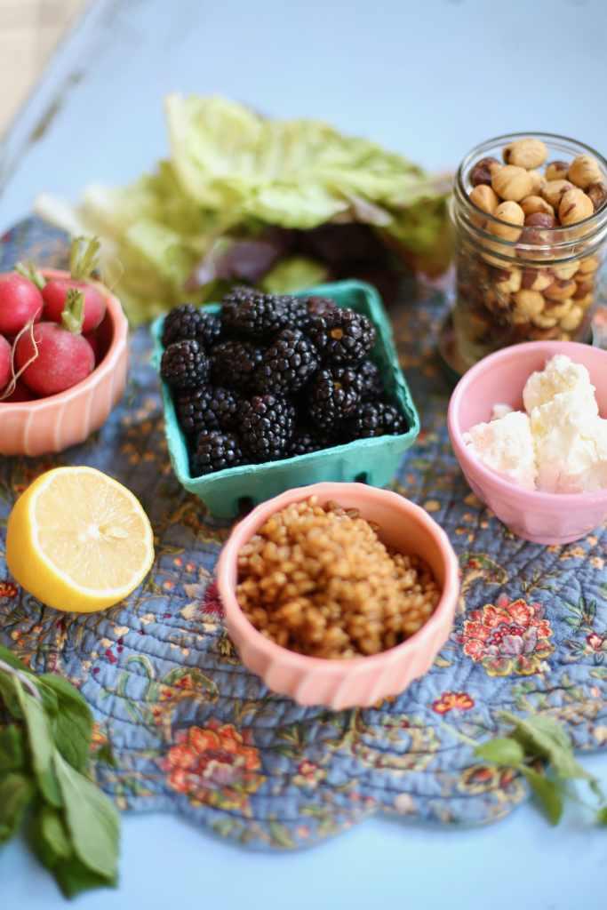 Blackberries, grains, lemon and goat cheese, lettuce and radish