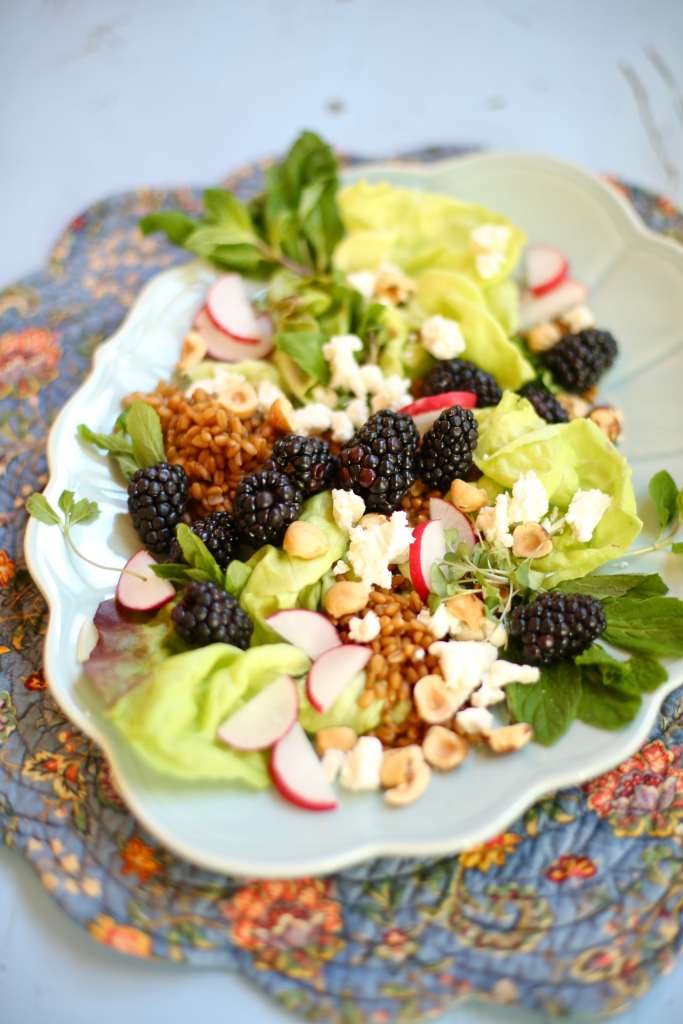 Blackberry Salad with Toasted Hazelnuts on a blue platter