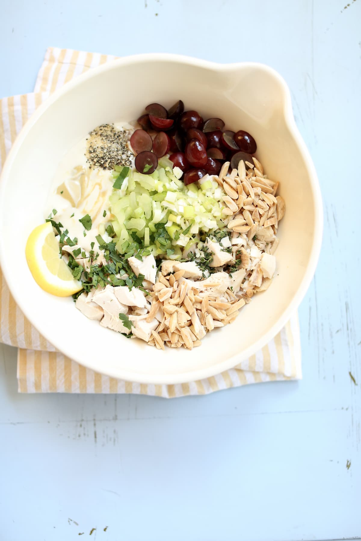 a bowl with ingredients for rotisserie chicken salad