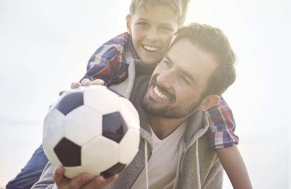 father and son with soccer ball.jpg