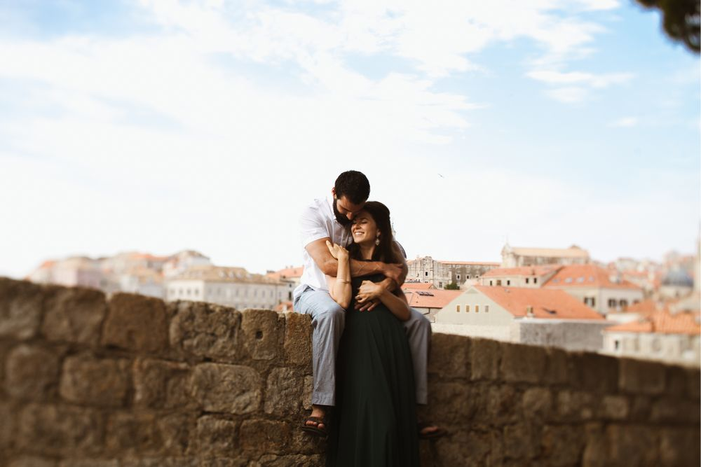 A newlyweds sitting on the wall in Dubrovnik.