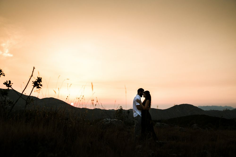 The newlywed couple enjoying sunrise during their early morning photo session in Dubrovnik.