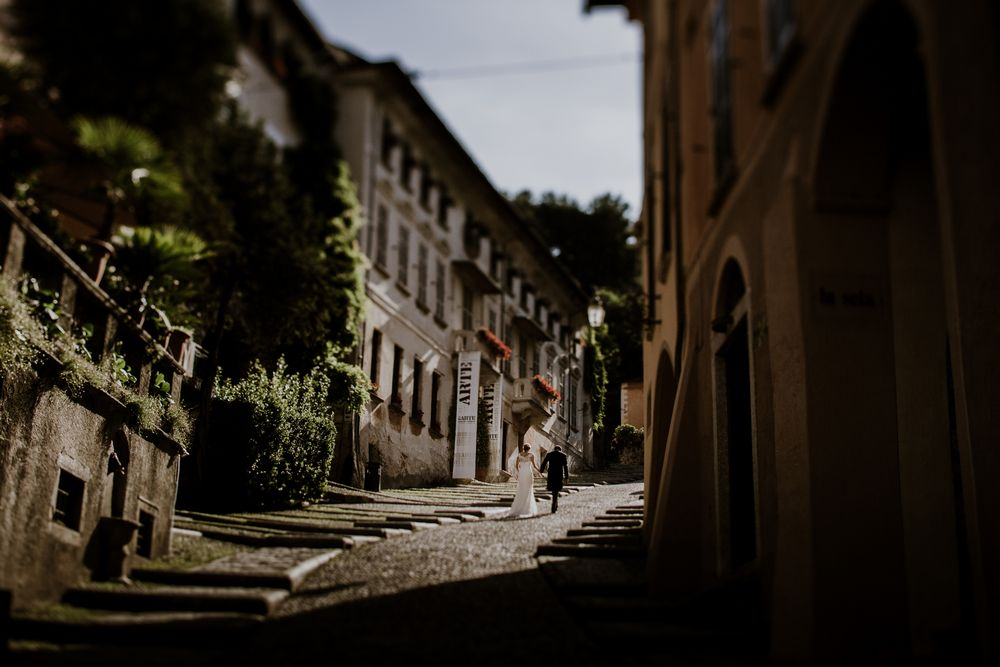 Lake Orta Wedding -  Wedding couple walking up to the Church of Santa Maria Assunta before the wedding ceremony in Italy. Lake Orta Wedding photographer & Videgrapher