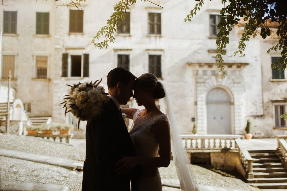 Italian lakes wedding - a newlyweds posing in front of the photo camera of talented Lake Como wedding photographer. Lake Orta Wedding photographer & Videographer
