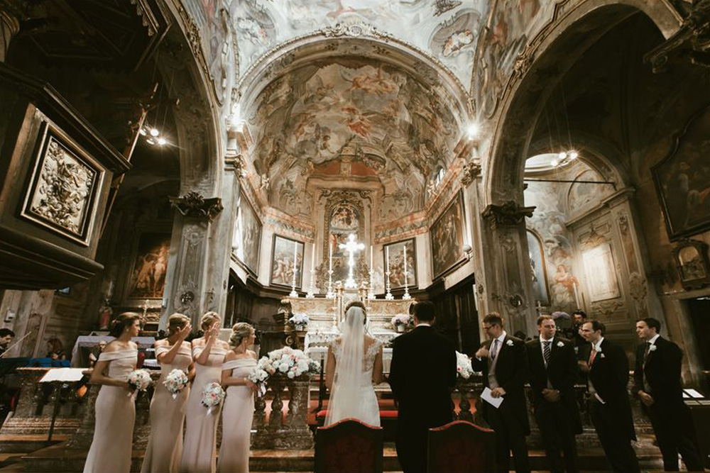 Bridal party in the stunning Church of Santa Maria Assunta at Lake Orta. Photo by DTstudio Italy wedding photographer
