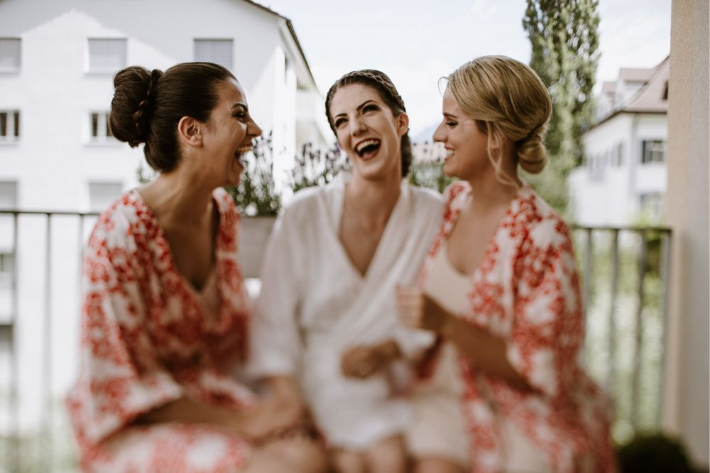 Bride with the bridesmaids during wedding preparations in Chur, Switzerland