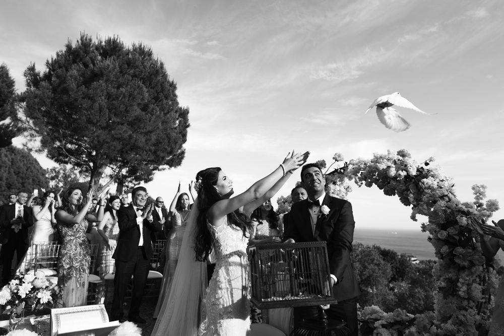 Marbella & Malaga weddings - White doves release during wedding ceremony. Marbella wedding videographer & photographer