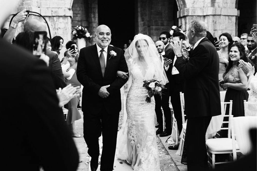 Bride walking down the aisle with her father, moments before getting married in Dubrovnik's Fort Lovrijenac