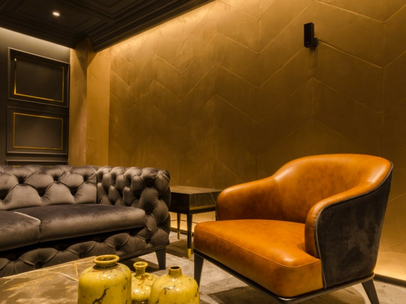 YELLOW COUCH, plush interior, black wall interior, black interiors, yellowinterior, kitsh interior, marylin monroe painting, art, high end interior design, luxury, posh, plush, fine, marble, italian, colors, wood , veneer, tv, samsung, dining, lounge, studio emergence, vintage decor, decor pieces, orange inteiror, architecture, statement, luxe, arches, interior, coffered ceiling