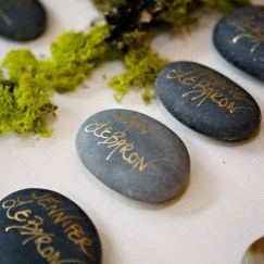 River stones : https://www.theknot.com/real-weddings/the-escort-cards-photo-79