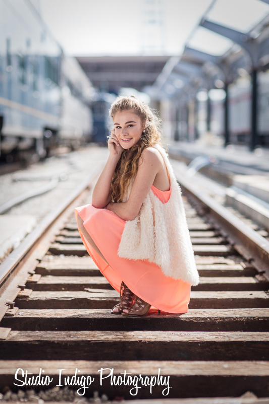 On the train tracks at a non-functioning train station so no worries about trains suddenly showing up.  Sarah very carefully leaning on the tracks for the high school senior portrait.  Shot entirely in natural light with the NIkon D750 and 85mm 1.4D lens.