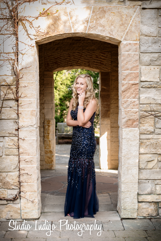 Becca in her prom dress at the Rose Gardein in olbrich gardens.  This full length portrait shows all of her beautiful prom dress.