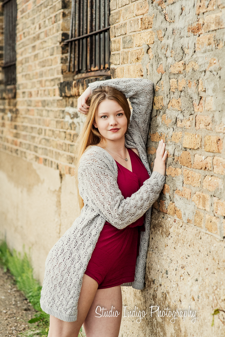 Jenna is a natural in front of the camera and we love this shot of her posed against a brick wall in downtown madison.