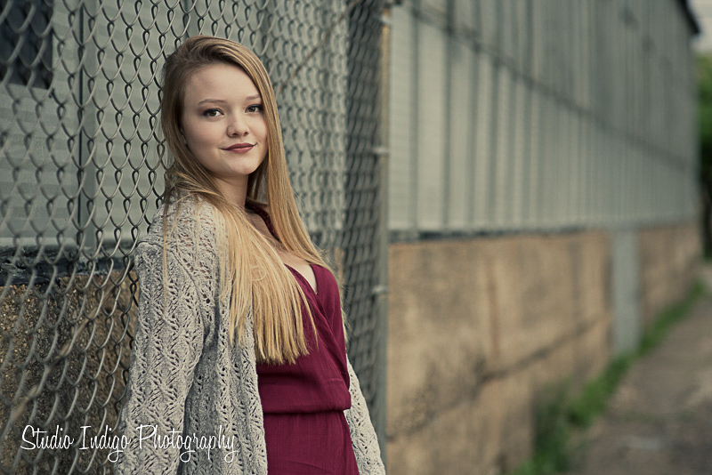 Love this senior portrait of Jenna leaning against a chain link fence.  We love shallow depth of field when photographing our senior pictures.  It gives the images a nice, soft look.