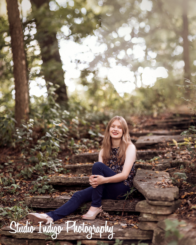 Sitting pose of madison west high school senior Maria captured using the Brenizer effect to intensify the shallow depth of field. Then applied a vintage effect in alienskin exposure 7 for this senior picture.