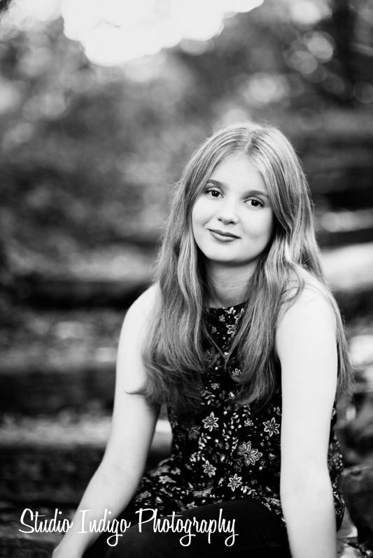 Natural sitting pose for high school senior Maria. We captured this senior portrait at Wingra Park in Madison WI. Black and White effect applied in Alienskin Exposure 7.