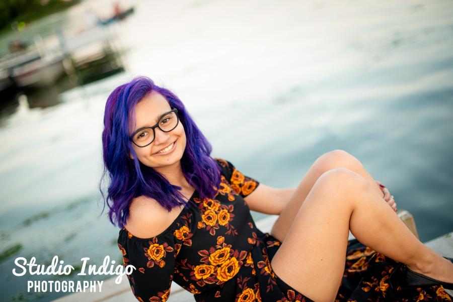 Senior portrait on the dock at Wingra Lake